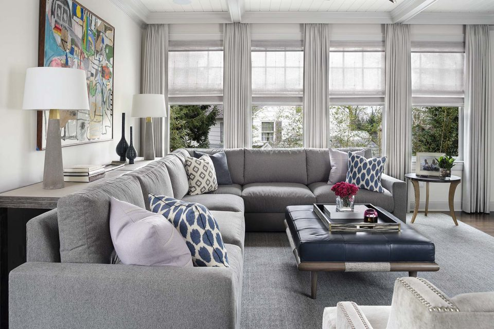 Bright Living Room with Ottoman and Sofa
