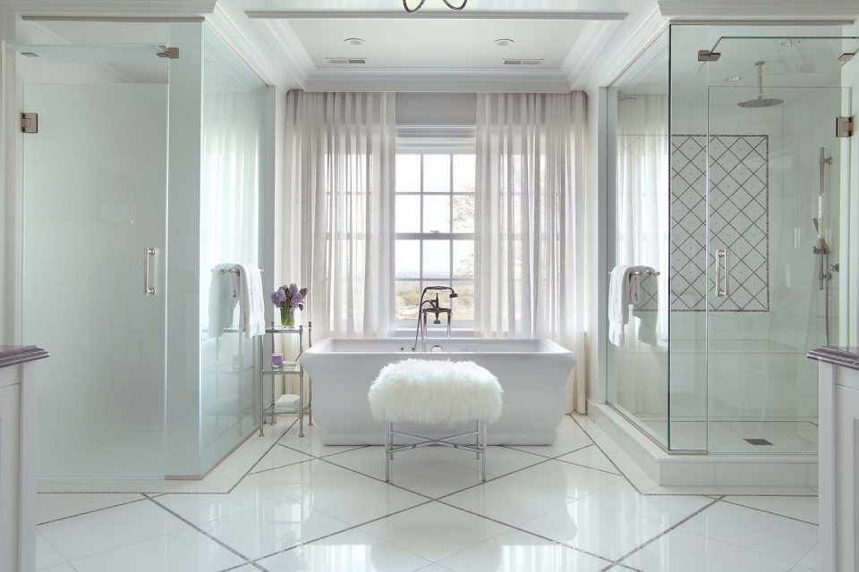 Clean White Master Bathroom with Tub Showers and Stool